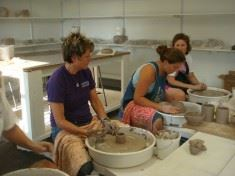 3 people molding clay